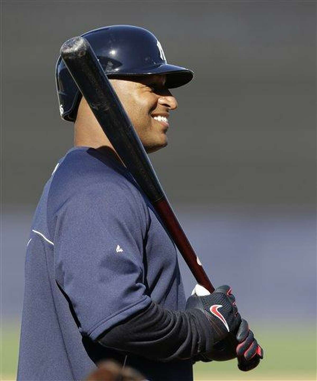 New York Yankees Vernon Wells holds a bat while waiting his turn in the cage after signing with the Yankees before a spring training baseball game at Steinbrenner Field in Tampa, Fla., Tuesday, March 26, 2013. Wells is in the lineup for Tuesday night's game against the Houston Astros. (AP Photo/Kathy Willens)