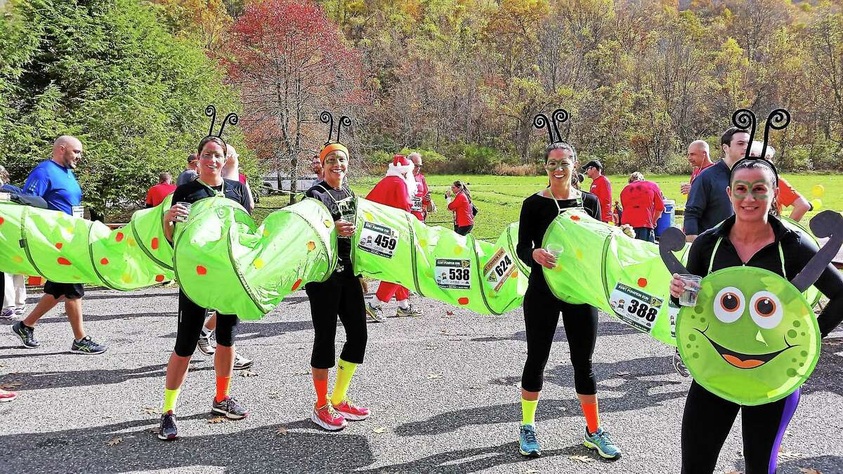 Recipients of the First-Place Best Costume Award went to ìThe Inchwormî ñ Kim Tessier of Litchfield; Elaine Rowano of Middlebury; Kristy Plath of Bristol; and Natalie DiVirgilio of Litchfield ñ at the five-mile 38th Annual Kent Pumpkin Run Sunday.
