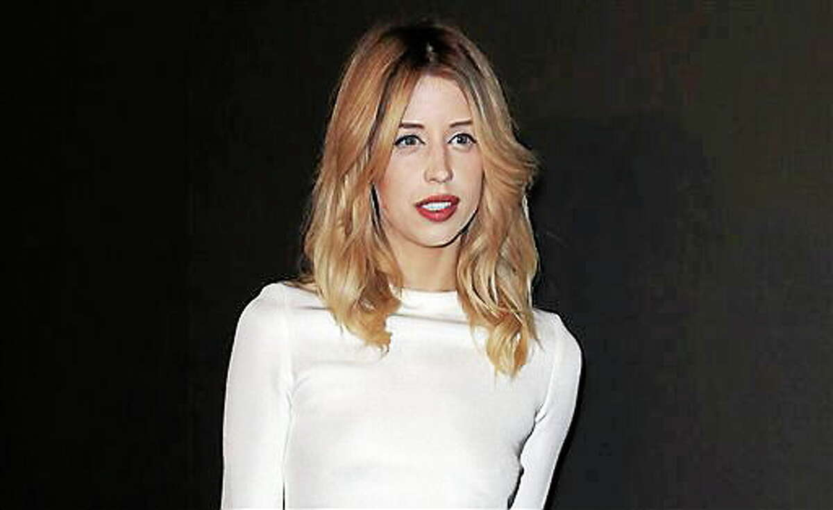"""FILE - In this Tuesday, Feb. 25, 2014 file photo, Peaches Geldof arrives to attend the ETAM's ready to wear fall/winter 2014-2015 fashion collection presented in Paris. Heroin is like to have played a role in the death of 25-year-old model and television personality Peaches Geldof, authorities said Thursday. Detective Chief Inspector Paul Fotheringham of the Kent and Essex Serious Crime Directorate told an inquest into the death of the second daughter of Live Aid organizer Bob Geldof that a post-mortem examination was inconclusive, prompting further tests. In a 10-minute hearing, Fotheringham discussed her final days. """"Recent use of heroin and the levels identified were likely to have played a role in her death,"""" he said. The news offers a sad echo of the death of her mother, television presenter Paula Yates, who died of a drug overdose in 2000 when Peaches Geldof was 11. In her final message on Twitter, she posted a photograph of herself as a toddler next to her mother along with the caption: """"Me and my mum."""" Peaches Geldof died at her home south of London on April 7. Inquests are held in Britain to determine the facts in sudden, violent or unexplained deaths. (AP Photo/C. d'Ettorre, file)"""