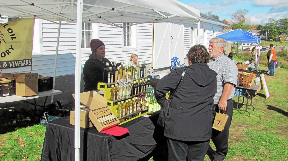 Customers browse a farmers market at South Farms in Morris Sunday as the farm rapped up its fall season.