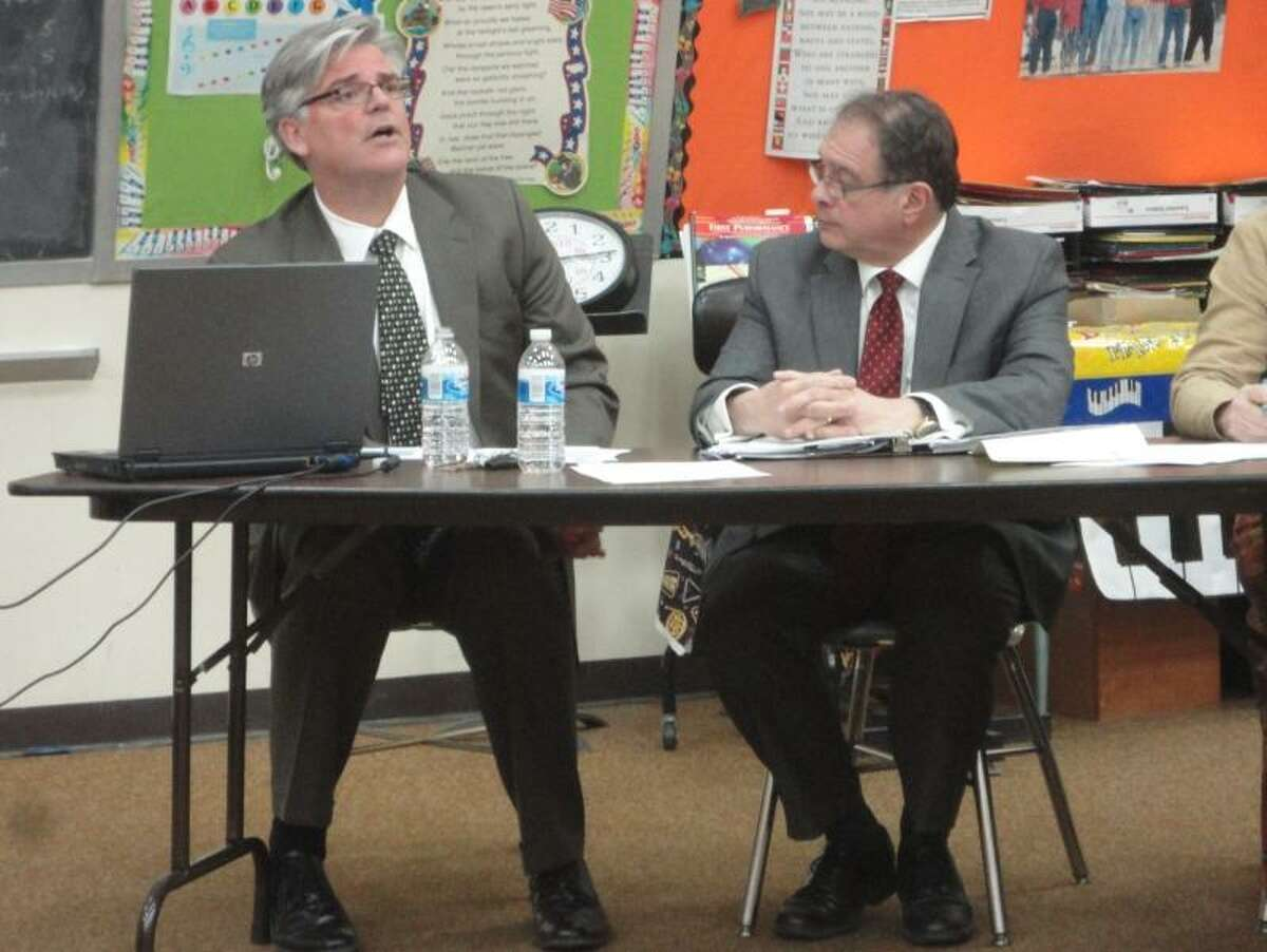 Photo by Jason Siedzik -- Winchester Superintendent of Schools Thomas Danehy, left, and Gilbert School Superintendent Anthony Serio run down their proposed budgets in a special joint meeting between the Board of Education and Board of Selectmen.