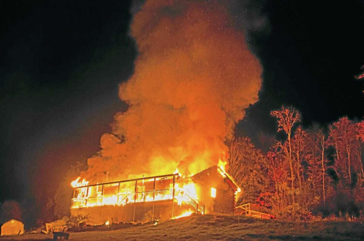 A fire rages on Danbury Quarter Road in Winchester on Oct. 16, 2013.