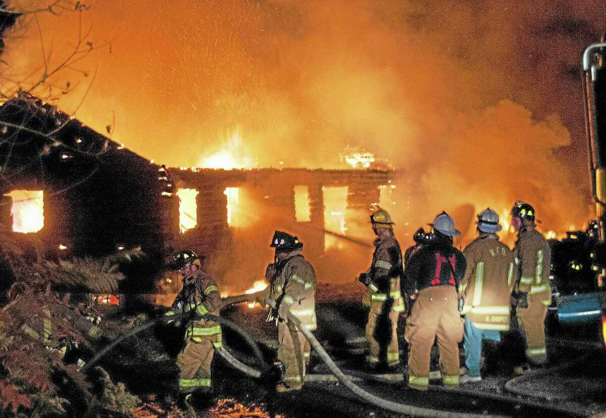Firefighters battle a fire on Danbury Quarter Road.