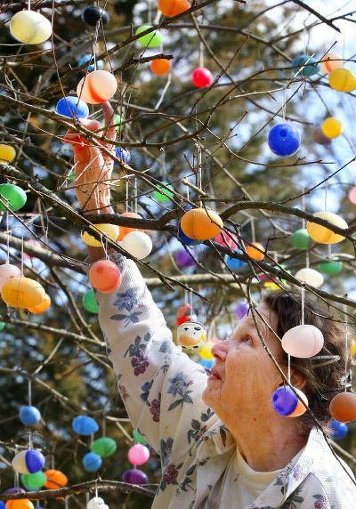 Elsie Palmer of Virginia begins to clean up vandalism left behind by the Easter Bunny earlier this month.