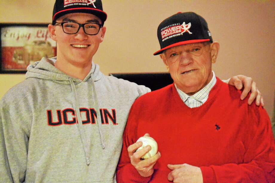 Northwestern's Zach Risedorf with Bill Marsh, who he sponsored this year at the Power Showcase in Miami. Risedorf went to Marsh's house on Jan. 10 to give him his first homerun ball. Photo: Pete Paguaga — Register Citizen