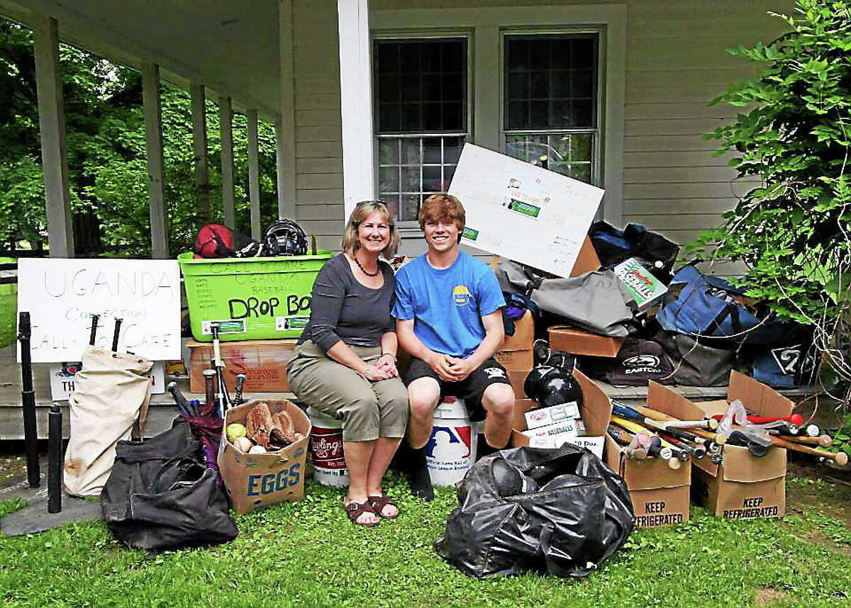 Housatonic's Willy Yahn and 'Call to Care Uganda' President Martha Hoffman over this past summer with some of the equipment that he has collected.