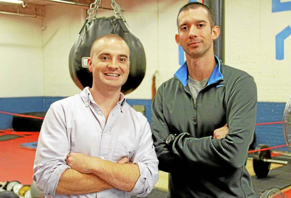 James O'Brien (left) and Matthew Harrington inside their fitness center on Tuesday, Oct. 15. The two men are veterans from Norfolk who between them served five tours in Afghanistan and Iraq. They decided to open a fitness center because it had been an aspiration for the two men.