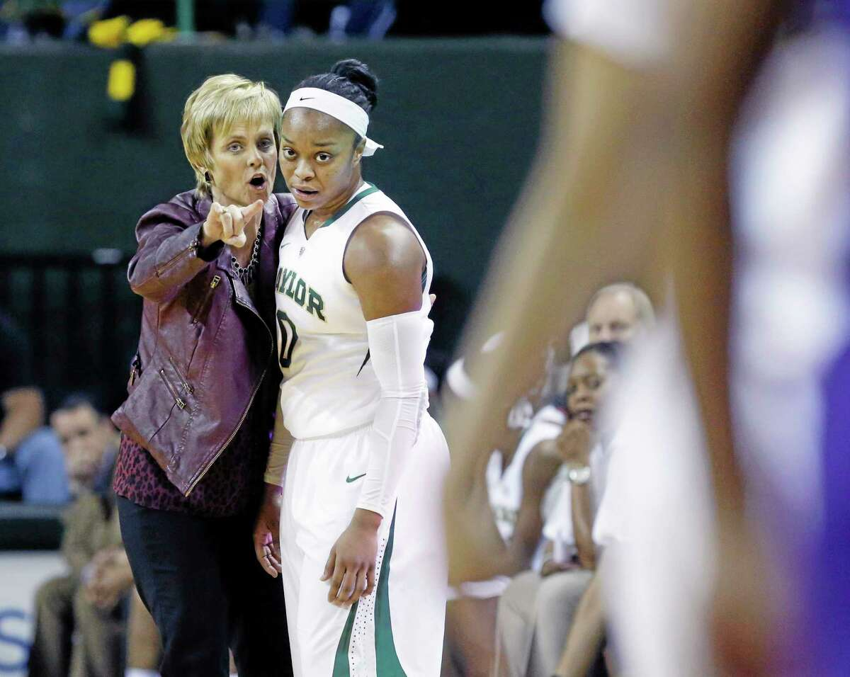 Coach Kim Mulkey, left, Odyssey Sims and the Baylor women's basketball team play host to top-ranked UConn on Monday in Waco, Texas.
