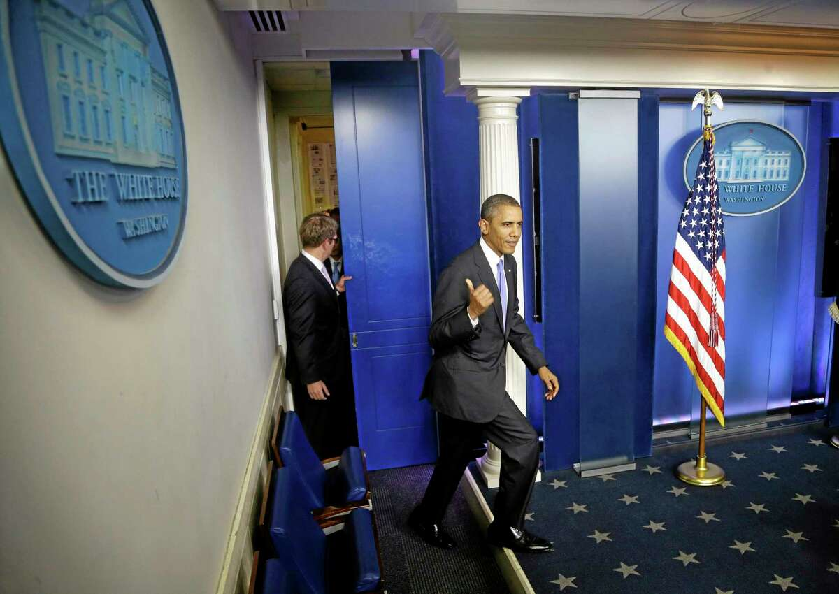 President Barack Obama walks out to make a statement to reporters in the Brady Press Briefing Room at the White House in Washington, Wednesday, Oct. 16, 2013. The Senate voted to avoid a financial default and reopen the government after a 16-day partial shutdown and the measure now heads to the House, which is expected to back the bill before day's end. (AP Photo/Pablo Martinez Monsivais)