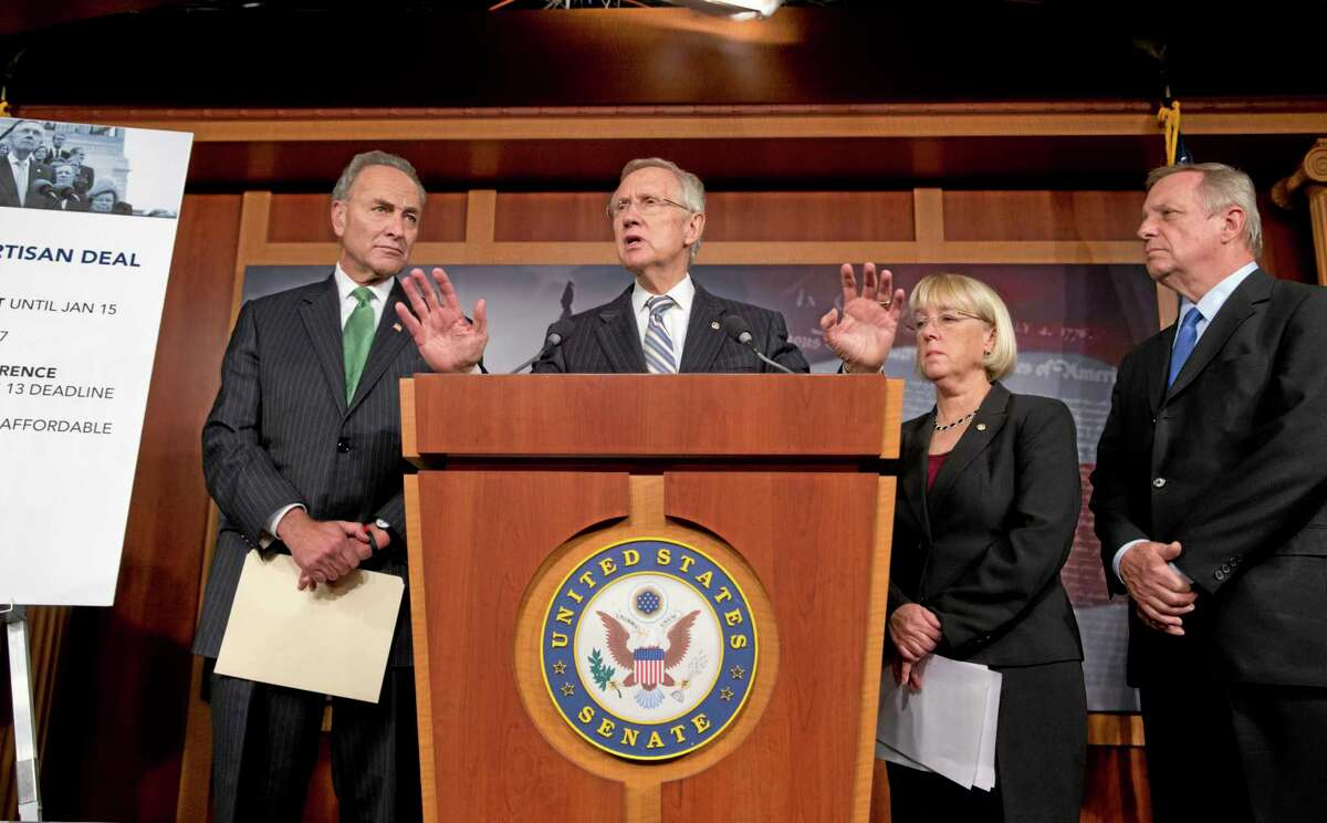 Senate Majority Leader Harry Reid, D-Nev., and Democratic leaders speak with reporters after voting on a measure to avert a threatened Treasury default and reopen the government after a partial 16-day shutdown, at the Capitol in Washington, Wednesday, Oct. 16, 2013. as Sen. Chuck Schumer, D-N.Y., Senate Majority Leader Harry Reid, D-Nev., Sen. Patty Murray, D-Wash., chair of the Senate Budget Committee, and Senate Majority Whip Dick Durbin, D-Ill., listen. (AP Photo/J. Scott Applewhite)