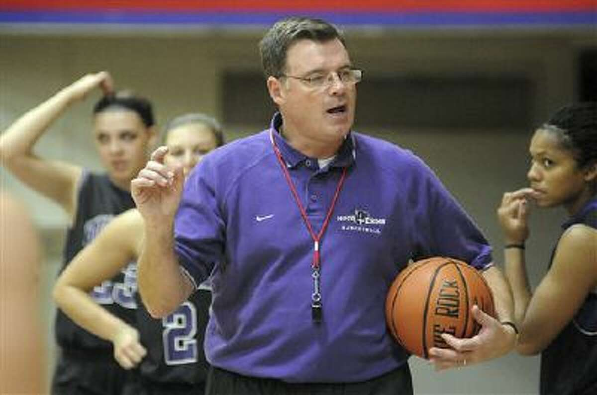 """In this Nov. 4, 2010 photo, Holy Cross women's basketball coach Bill Gibbons outlines a play for his team during practice at the Hart Center in Worcester, Mass. Former Holy Cross player Ashley Cooper, 20, filed a lawsuit in New York Tuesday, Oct. 15, 2013, against the school, Gibbons, and school officials claiming Gibbons was """"verbally, emotionally and physically abusive."""" (AP Photo/The Telegram & Gazette, Steve Lanava)"""