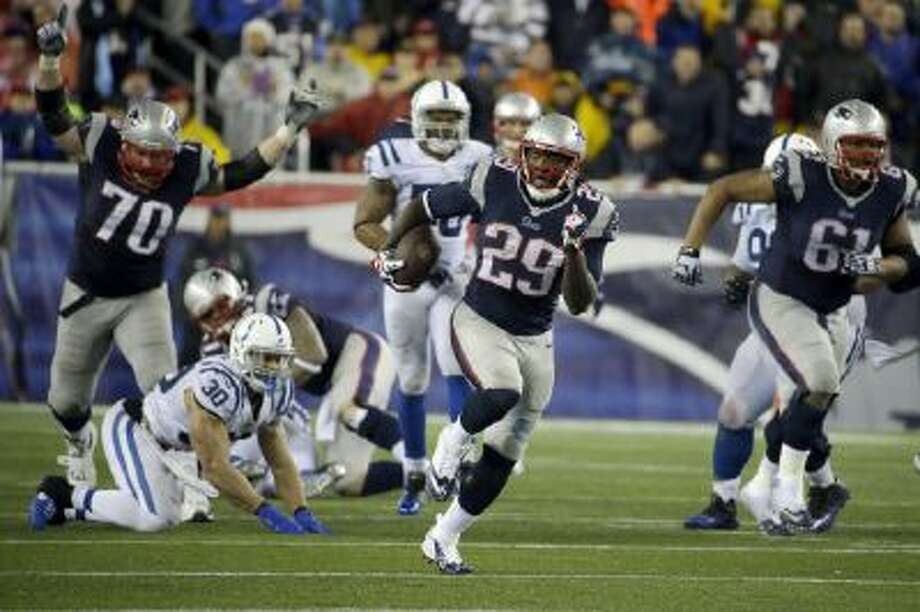 New England Patriots running back LeGarrette Blount (29) heads downfield for a touchdown during the second half against the Colts Saturday.