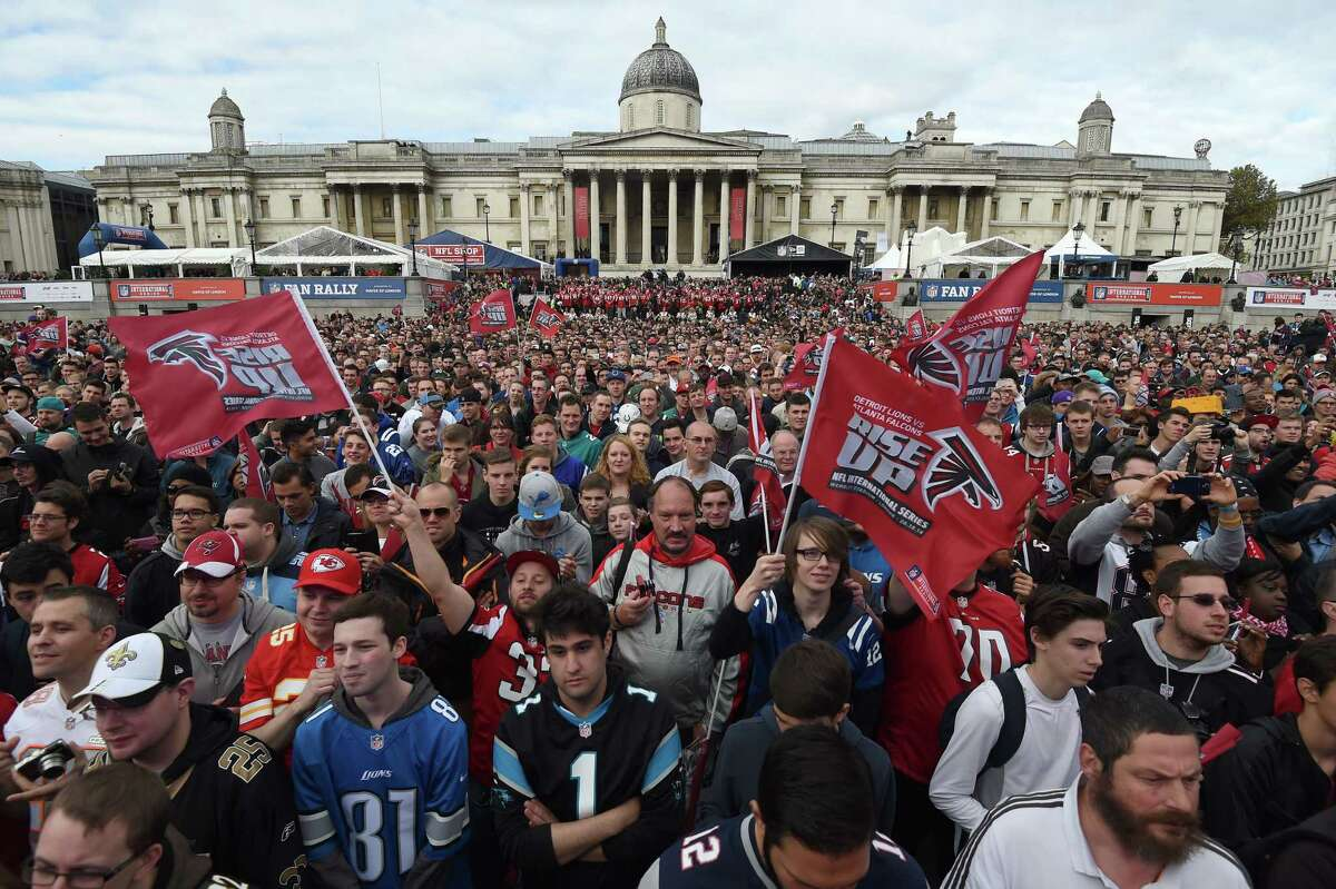 Football fans wave flags during the NFL Fan Rally on Saturday in Trafalgar Square in London. The National Gallery of art is in the background. The Atlanta Falcons will play the Detroit Lions on Sunday at Wembley Stadium in a contest which will be broadcast live on the East Coast at 9:30 a.m. Register sports columnist Chip Malafronte believes the Sunday morning NFL game should become a weekly happening.
