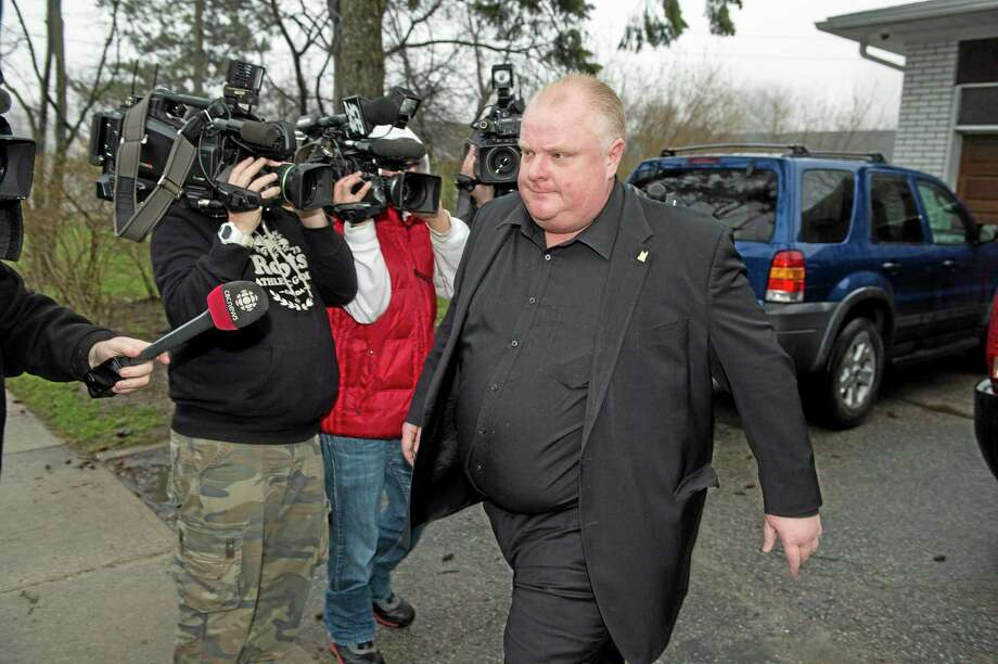 Toronto Mayor Rob Ford leaves his home early Thursday May 1, 2014, in Toronto. Ford will take an immediate leave of absence to seek help for alcohol, he said, as a report surfaced about a second video of the mayor smoking what appears to be crack cocaine. (AP Photo/The Canadian Press, Frank Gunn) Photo: AP / The Canadian Press