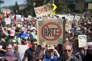 People hold up signs during a rally against hate in Berkeley, Calif., Sunday, Aug. 27, 2017. (AP Photo/Josh Edelson)