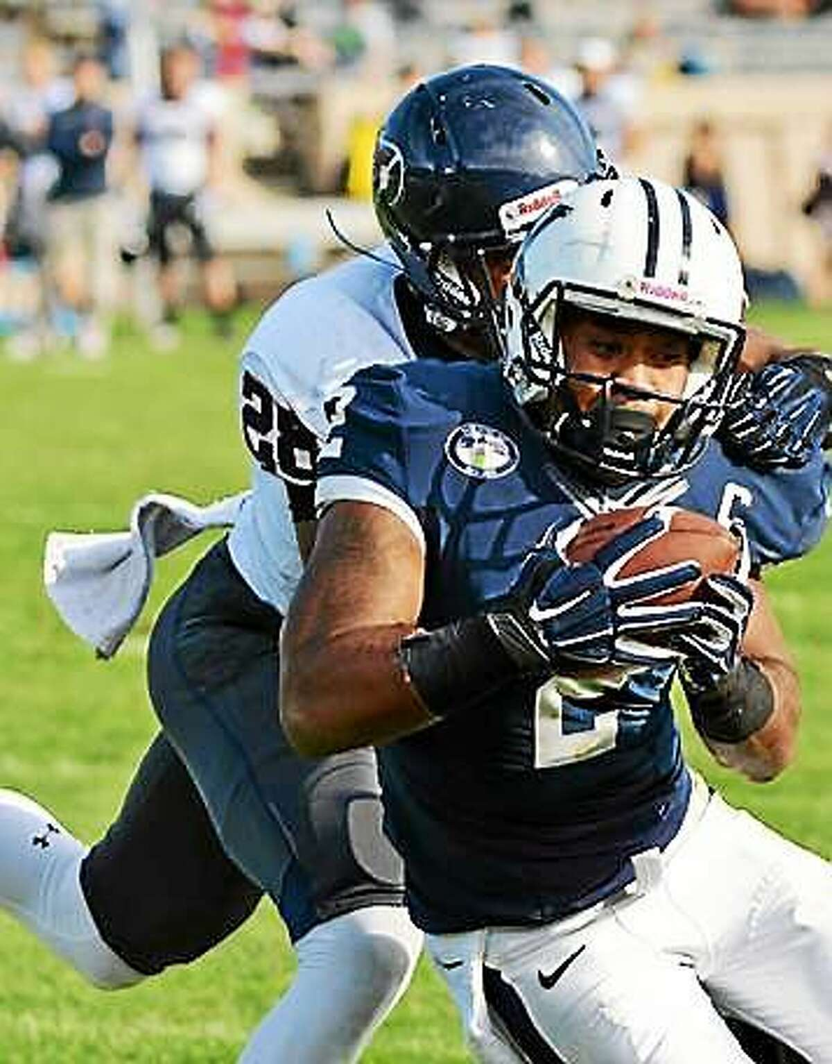 Yale receiver Deon Randall makes his 196th career reception to set the program record during Saturday's 43-21 win over Penn at Yale Bowl.
