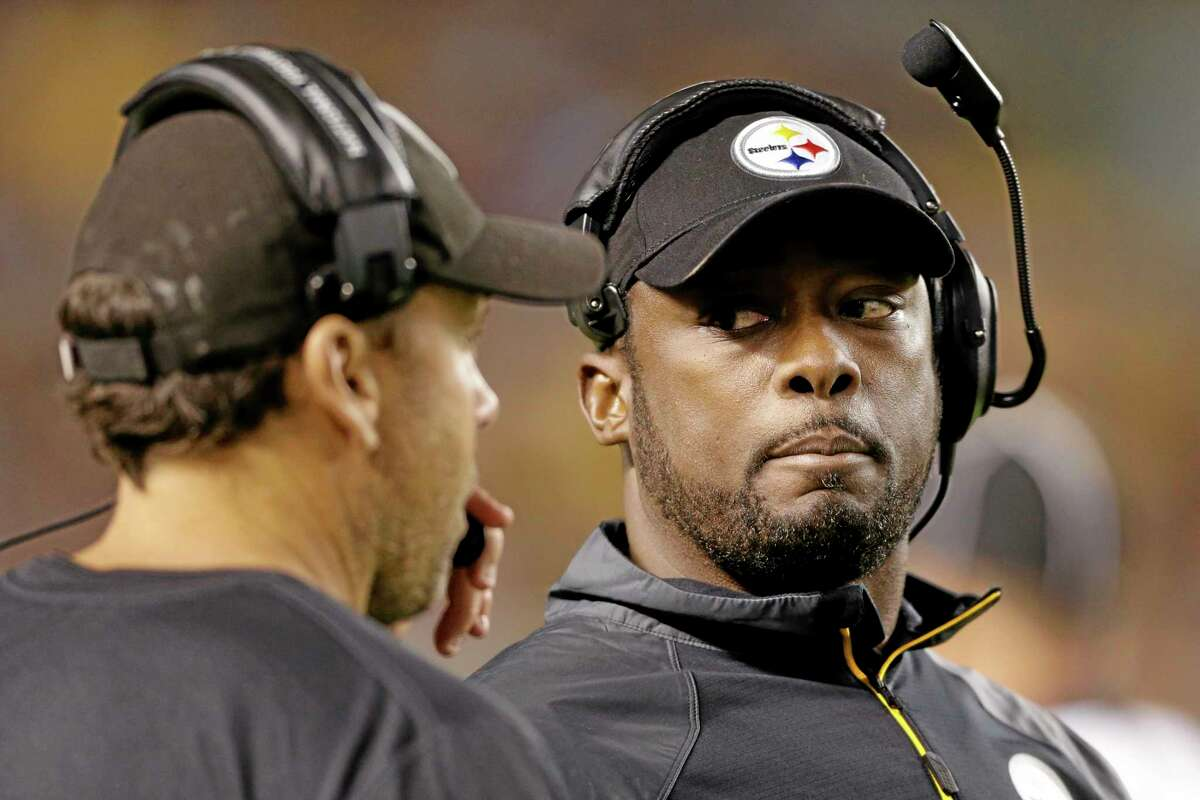 Pittsburgh Steelers head coach Mike Tomlin, right, and offensive coordinator Todd Haley will have to manage the rest of the season without offensive tackle Levi Brown and tight end David Johnson.