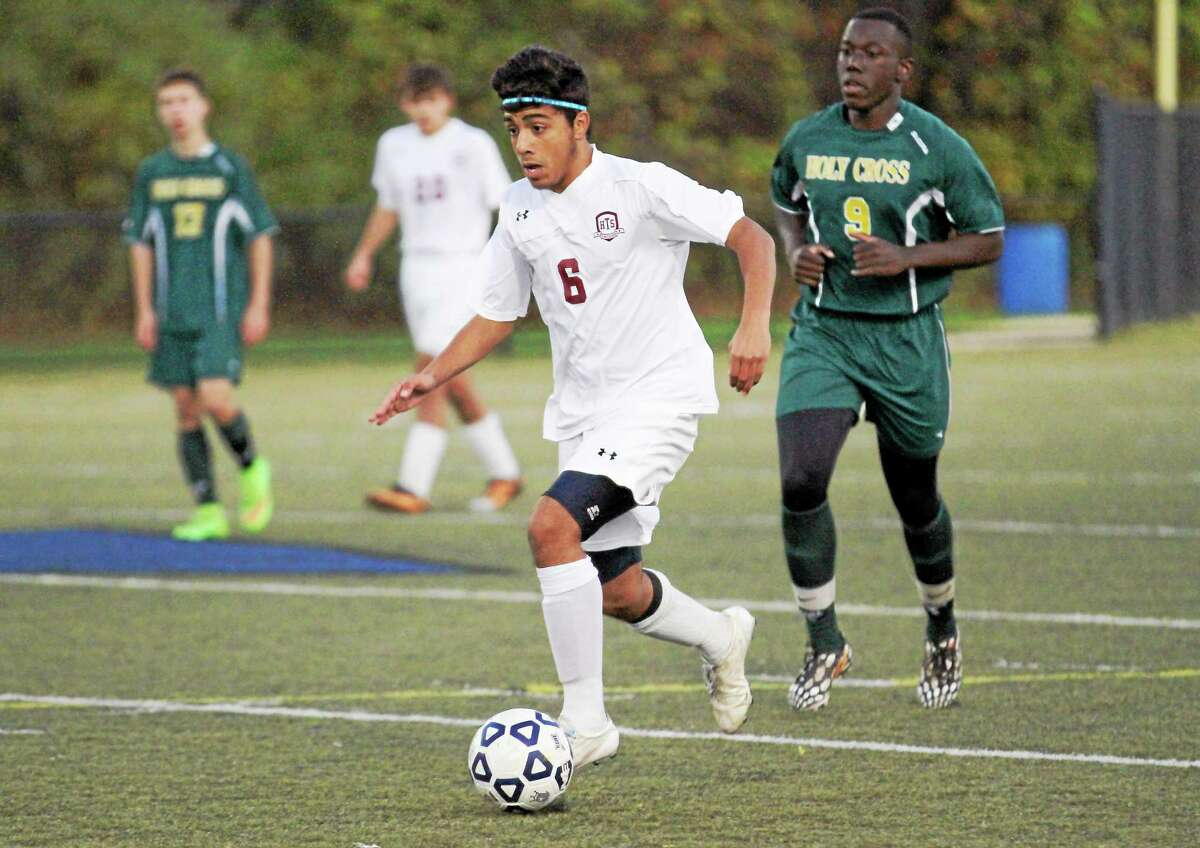 Torrington's Mike DeSousa dribbles the ball in his team's win over Holy Cross Saturday night at Municipal Stadium.