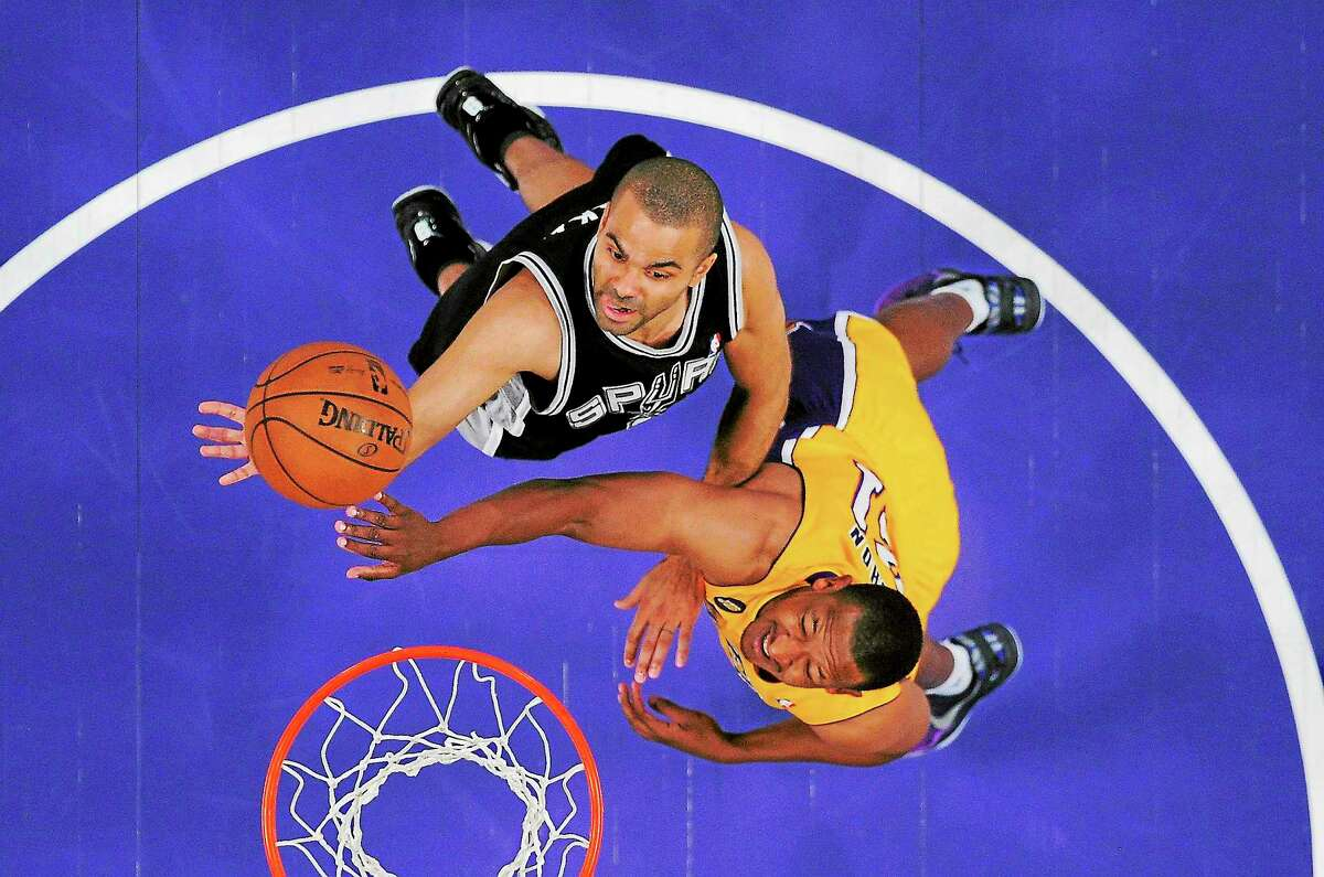 San Antonio Spurs guard Tony Parker, left, puts up a shot as Los Angeles Lakers guard Chris Duhon defends during the first half in Game 3 of the first round of the Western Conference playoffs on April 26 in Los Angeles.