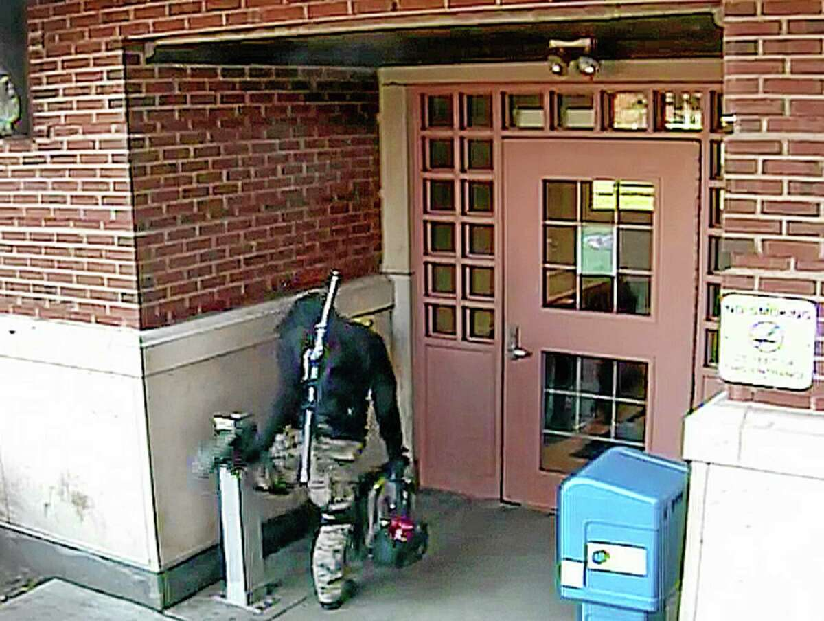In this Monday, Nov. 4, 2013 photo provided by Central Connecticut State University senior David Kyem, 21, son of CCSU geography professor Peter Kyem is seen outside a campus building in New Britain, Conn. Reports of a person carrying a sword led to a 3-hour campus lockdown. Kyem, 21, was charged with breach of peace and posted bail Monday. His father says his son caused the commotion while returning to his dorm in a costume after attending a party. University spokesman Mark McLaughlin says officials will decide whether Kyem can return to campus after police and school investigations are completed.(AP Photo/Courtesy of Central Connecticut State University)