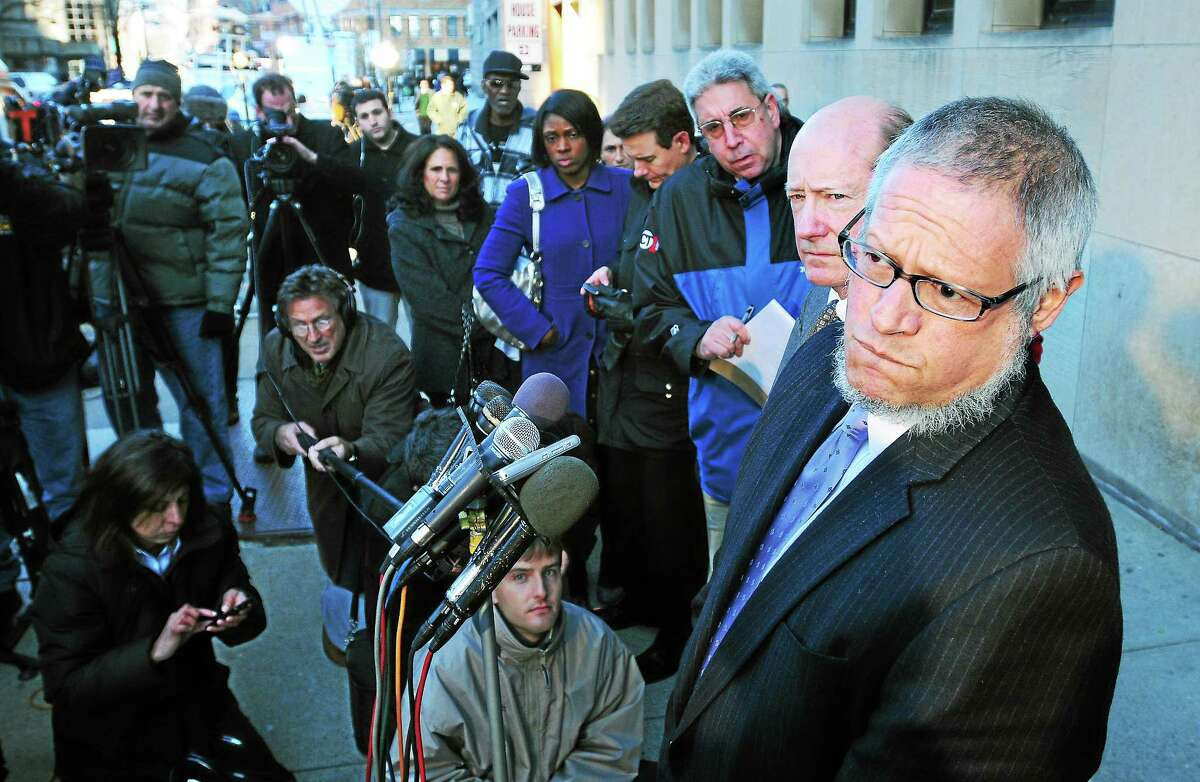 File photo: Steven Hayes' defense attorneys Patrick Culligan (right) and Thomas Ullmann (far right) speak to media in front of Superior Court in New Haven after Hayes was officially sentenced to death on 12/2/2010.