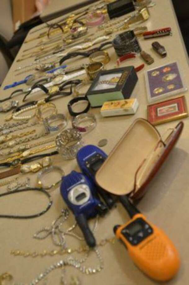 Items confiscated from the home of Todd Lloyd Griffin, who is accused of robbing people while they were attending funerals.