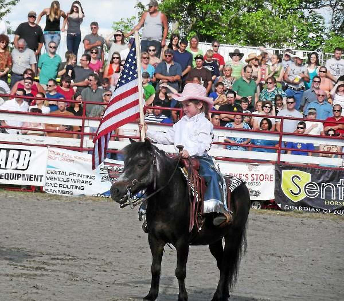 Summerline O'Neill, 5, goes out into the arena at the Goshen Stampede before the rodeo begins. (Register Citizen File Photo)