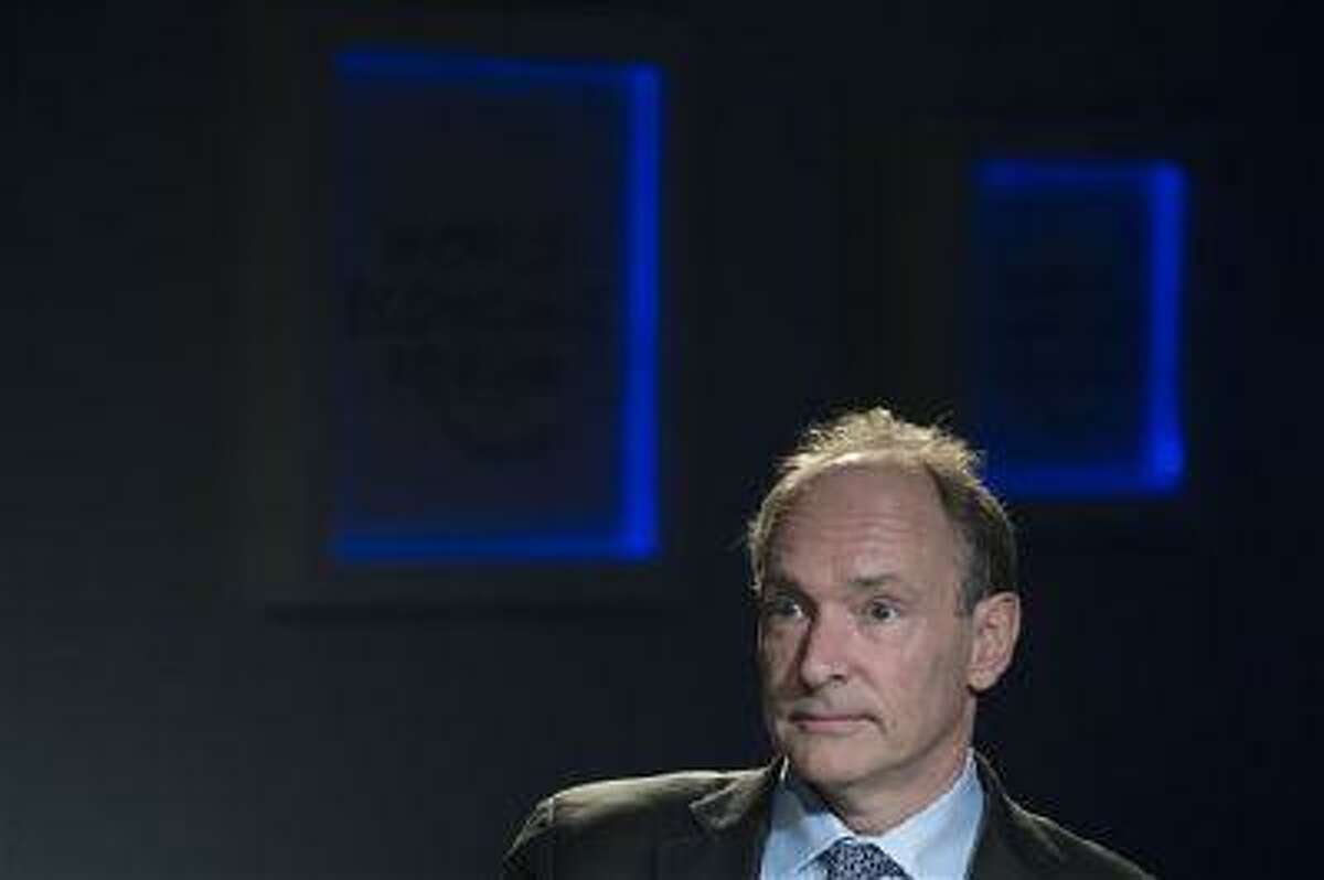 In this Friday, Jan. 25, 2013 file photo, Tim Berners-Lee, director of World Wide Web Foundation, speaks during a panel session at the 43rd Annual Meeting of the World Economic Forum, WEF, in Davos, Switzerland. The scientists at the European Organization for Nuclear Research, known by its French acronym CERN, are searching for the first Web page. It was there that Berners-Lee invented the Web in 1990 as an unsanctioned project. (AP Photo/Keystone, Jean-Christophe Bott/File)