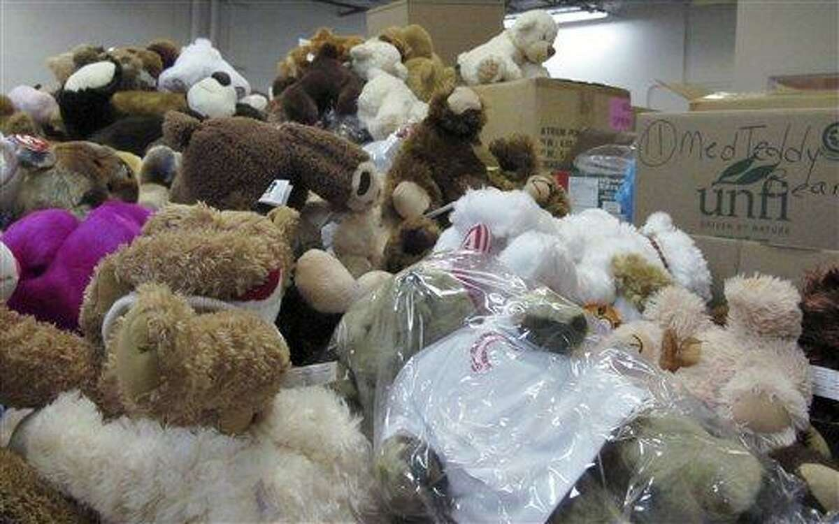 In this Monday, Dec. 31, 2012 photo, piles of donated stuffed animals await sorting in a warehouse in Newtown, Conn. AP Photo/Pat Eaton-Robb
