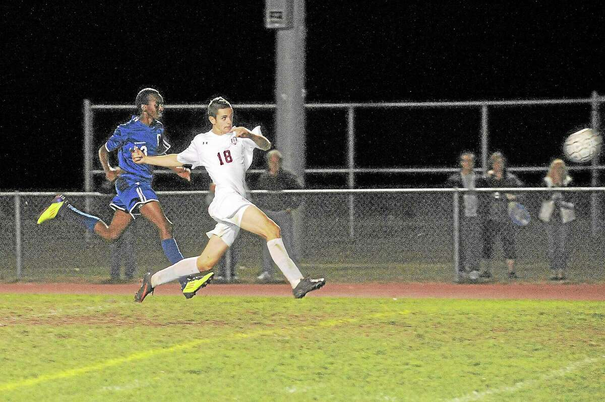 Torrington's Griffin Pelkey shoots on net during the Red Raiders 7-0 win over Crosby. Pelkey had one assist in the win.