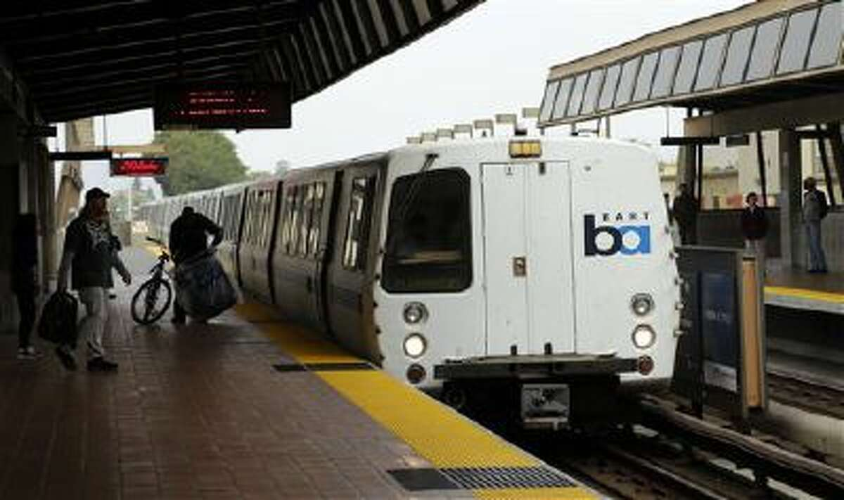 Bay Area Rapid Transit travelers wait to board an arriving train in Oakland, Calif., on Oct. 12. BART and union leaders resumed negotiations Monday.