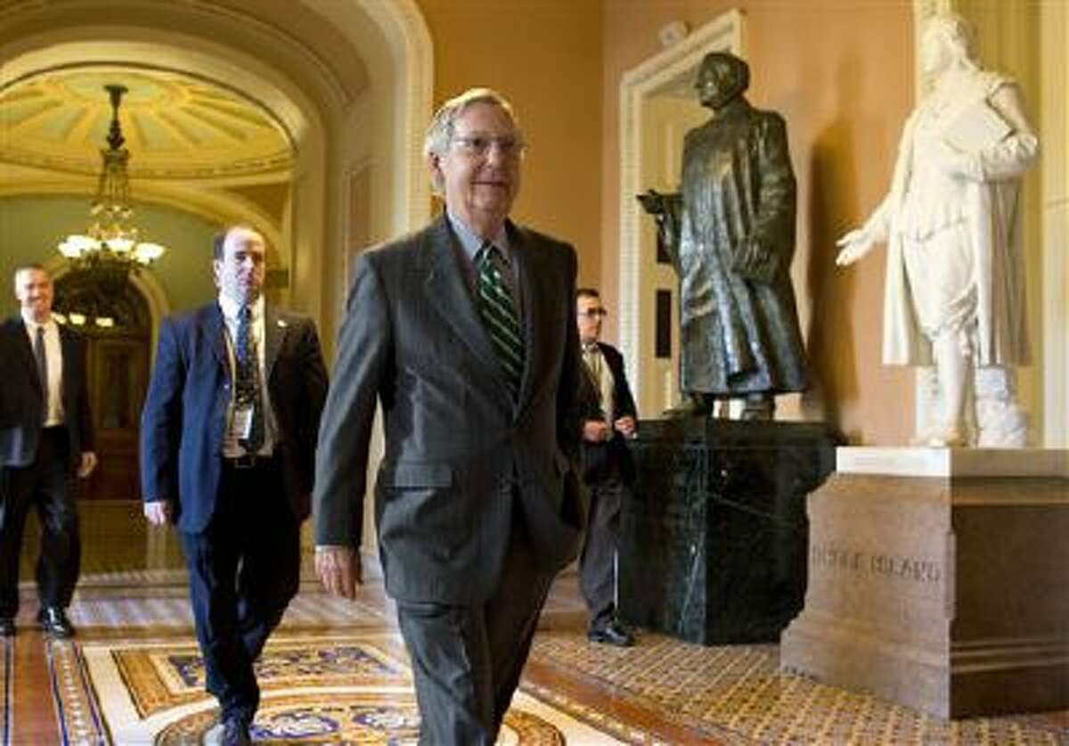 Senate Minority Leader Sen. Mitch McConnell, R-Ken., walks to his office after arriving on Capitol Hill on Monday.