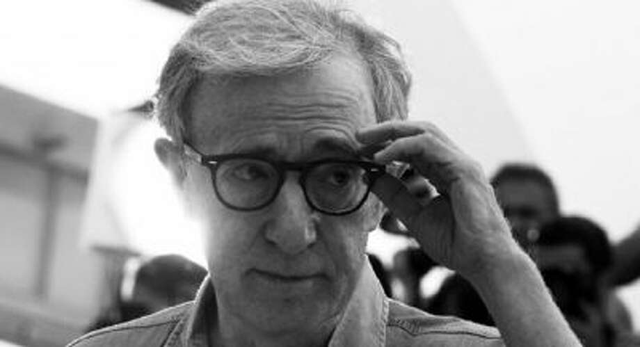 US director Woody Allen poses during the photocall of 'Midnight in Paris' presented out-of-competition at the 64th Cannes Film Festival on May 11, 2011 in Cannes.