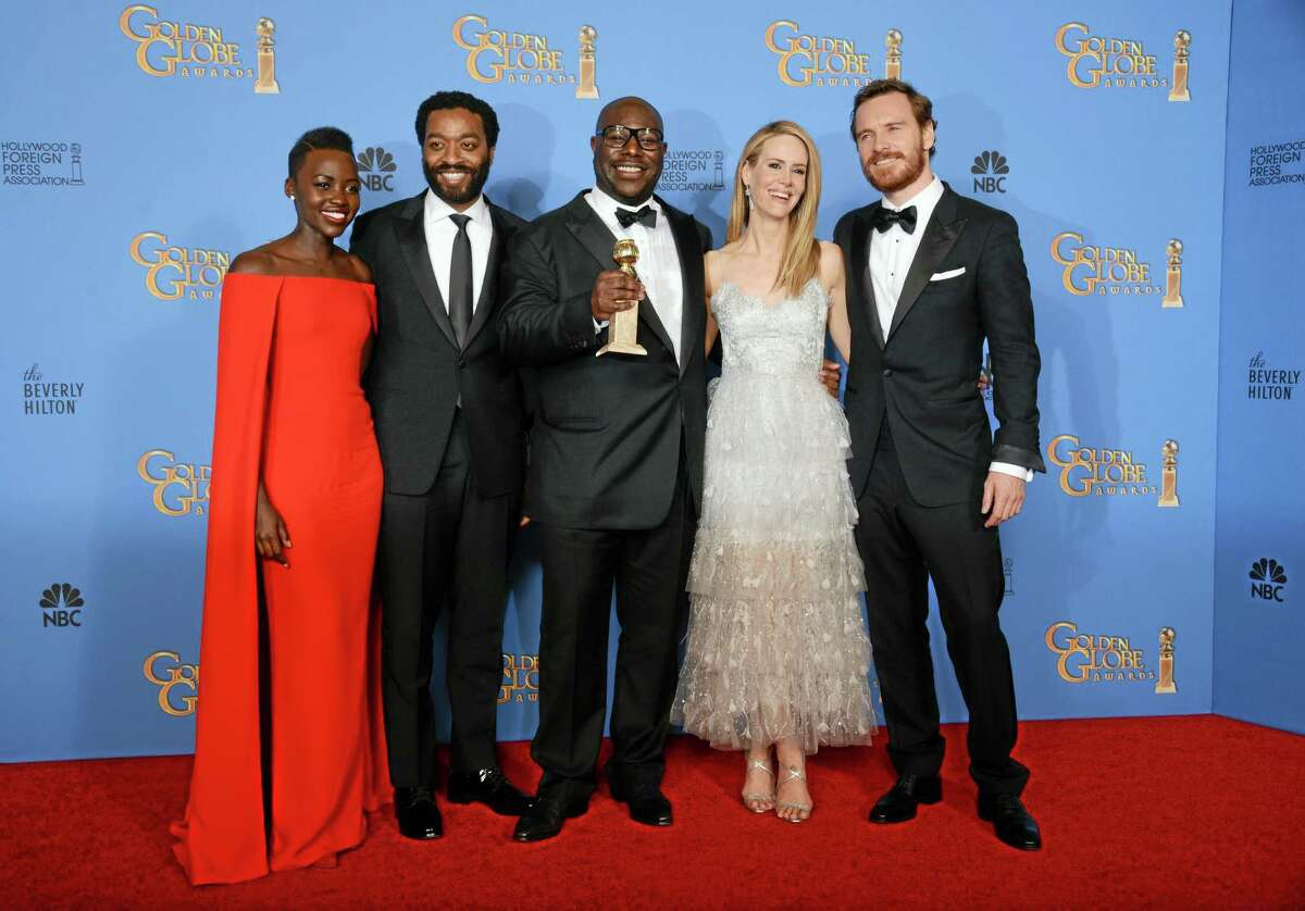 """From left, Lupita Nyong'o, Chiwetel Ejiofor, Steve McQueen, Sarah Paulson and Michael Fassbender pose in the press room with the award for best motion picture - drama for """"12 Years a Slave"""" at the 71st annual Golden Globe Awards at the Beverly Hilton Hotel on Sunday, Jan. 12, 2014, in Beverly Hills, Calif. (Photo by Jordan Strauss/Invision/AP)"""