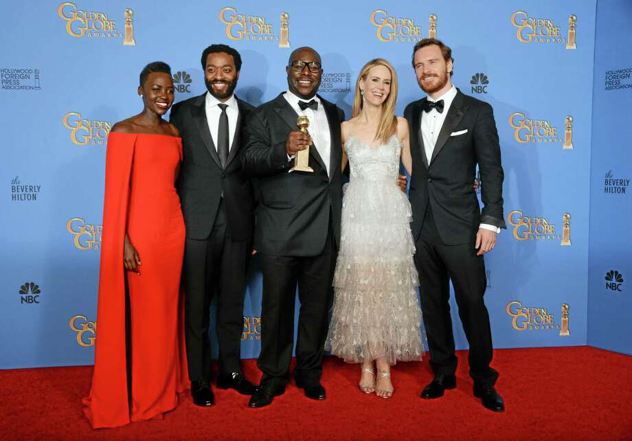 """From left, Lupita Nyong'o, Chiwetel Ejiofor, Steve McQueen, Sarah Paulson and Michael Fassbender pose in the press room with the award for best motion picture - drama for """"12 Years a Slave"""" at the 71st annual Golden Globe Awards at the Beverly Hilton Hotel on Sunday, Jan. 12, 2014, in Beverly Hills, Calif. (Photo by Jordan Strauss/Invision/AP) Photo: Jordan Strauss/Invision/AP / Invision"""