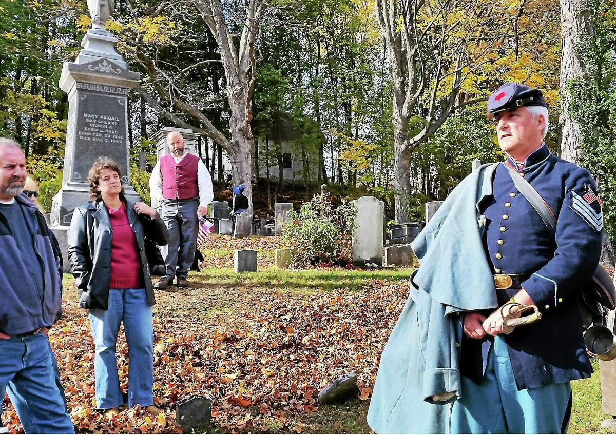 Mike Mueller of Winsted plays Civil War local figure Sgt. Major Lyman Coe Loomis at the second annual cemetery walk, this year at Old Burying Ground at 61 Park Place on Saturday afternoon. Proceeds for the walk went to restoring the Winchester Soldiers' Monument.