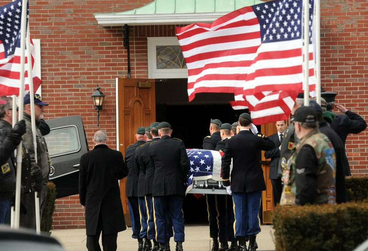 St. George Church, Guilford: The body of Capt. Andrew Pedersen-Keel, killed in Afghanistan, was brought into the church for his funeral. Mara Lavitt/New Haven Register3/25/13