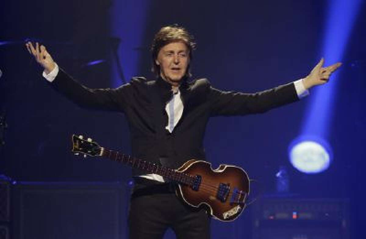 """In this Saturday, May 18, 2013 photo, Paul McCartney performs during the first U.S concert of his """"Out There"""" tour, in Orlando, Fla."""