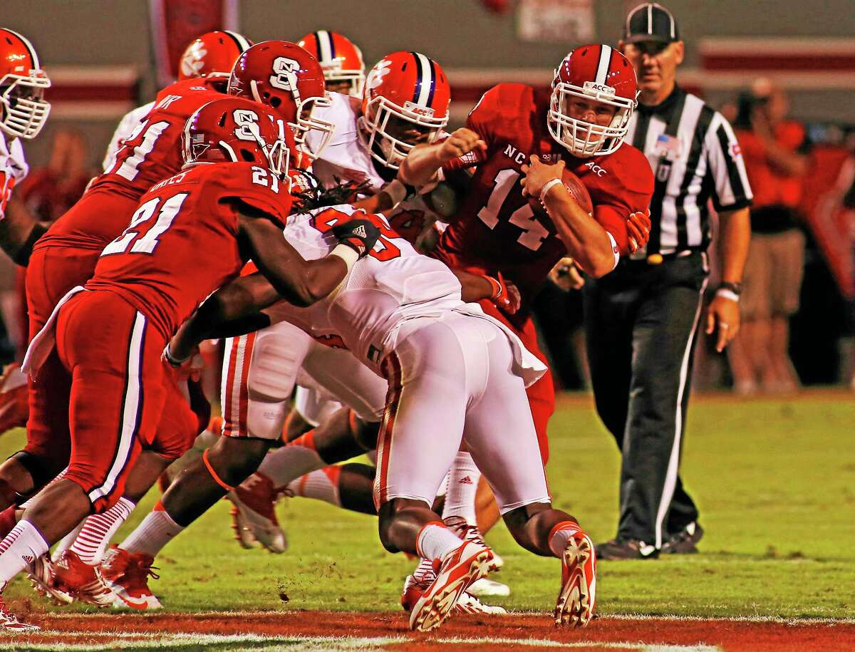 N.C. State's Bryant Shirreffs (14) struggles for yardage against Clemson during a Sept. 19, 2003, game in Raleigh, N.C.