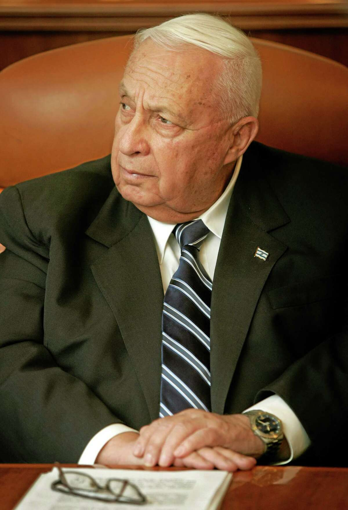 FILE - In this Dec. 12, 2005, photo file photo, Israeli Prime Minster Ariel Sharon attends a meeting at his office in Jerusalem. Sharon, the hard-charging Israeli general and prime minister who was admired and hated for his battlefield exploits and ambitions to reshape the Middle East, died Saturday, Jan. 11, 2014. He was 85. (AP Photo/Oded Balilty, File)