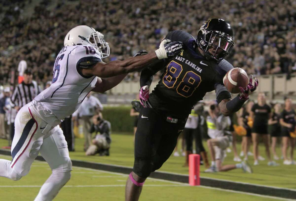 East Carolina's Trevon Brown cannot come down with a pass in the end zone ahead of UConn's Byron Jones during Thursday night's game in Greenville, N.C.