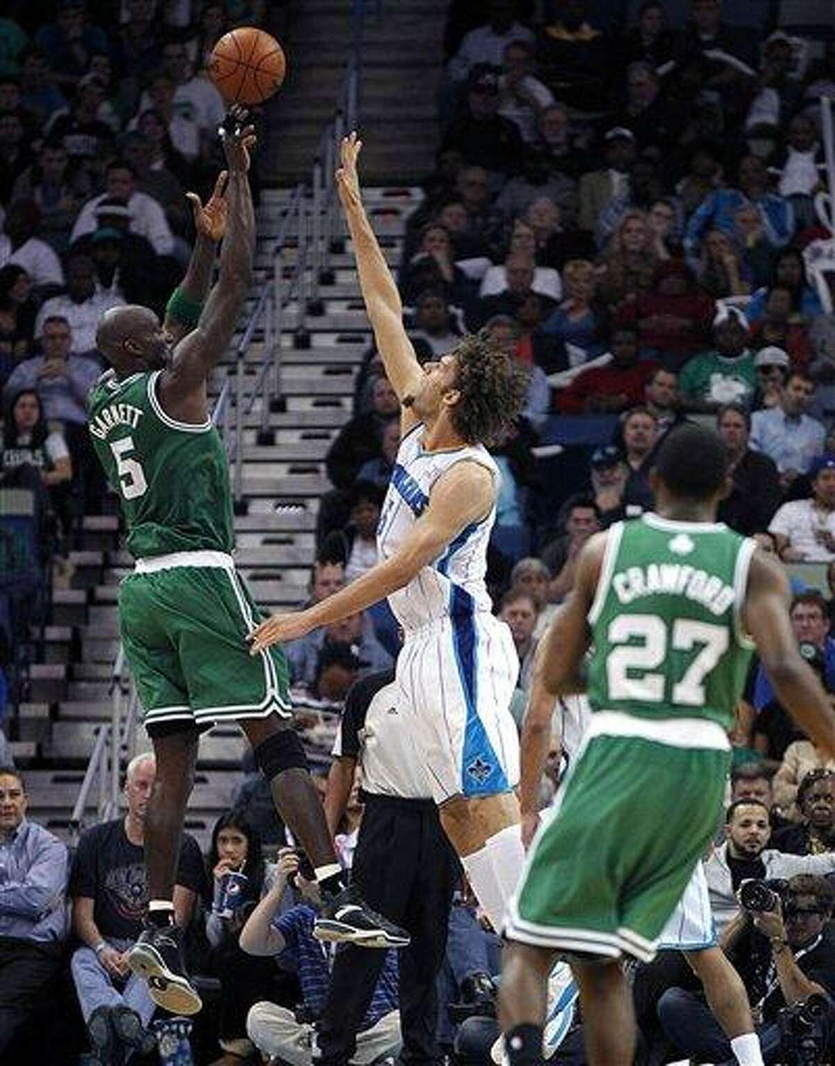 Boston Celtics center Kevin Garnett (5) shoots over New Orleans Hornets center Robin Lopez in the second half of an NBA basketball game in New Orleans, Wednesday, March 20, 2013. The Hornets won 87-86. (AP Photo/Gerald Herbert)