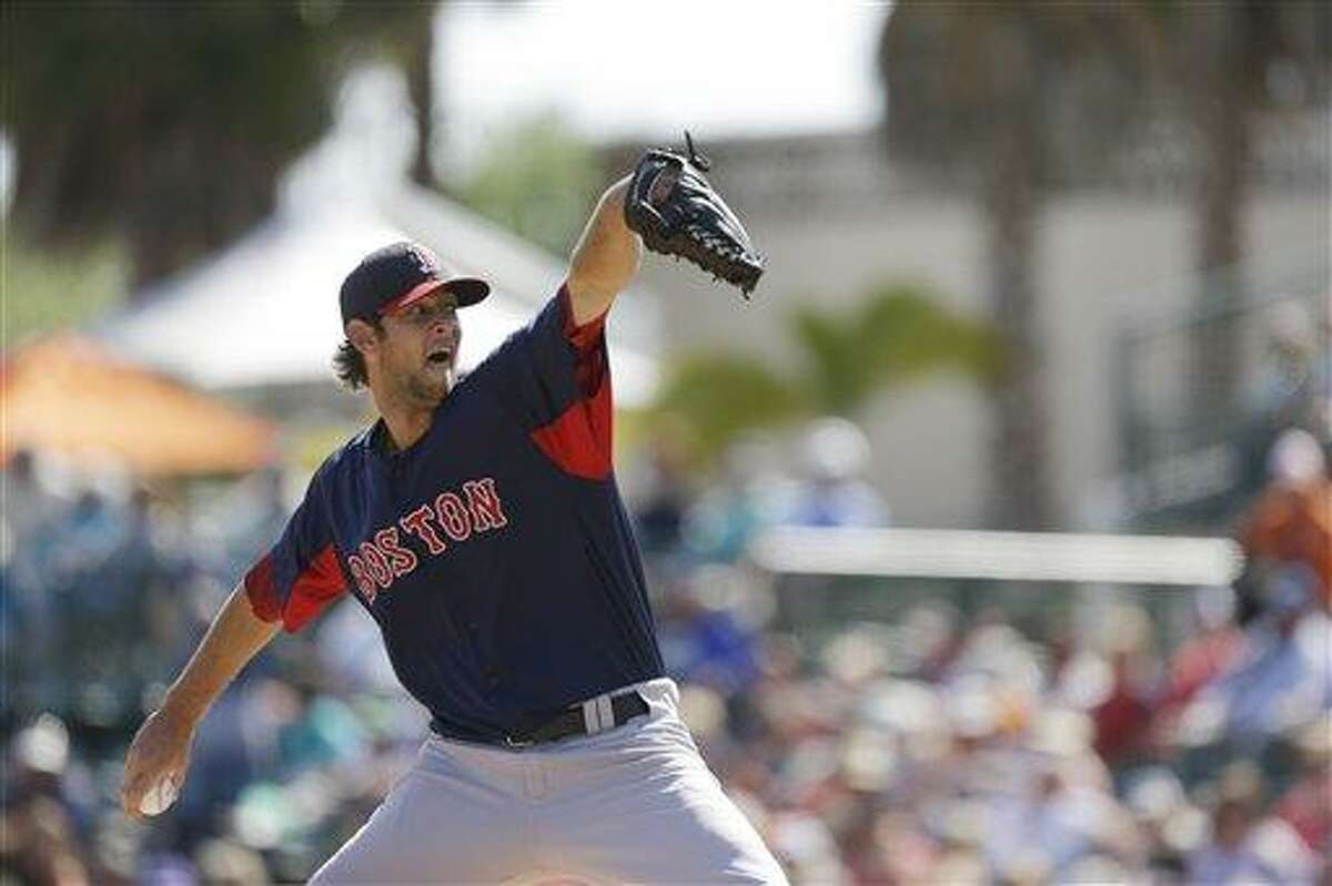 Boston Red Sox relief pitcher Christopher Martin throws during the eighth inning of an exhibition spring training baseball game against the Baltimore Orioles, Monday, March 25, 2013 in Sarasota, Fla. (AP Photo/Carlos Osorio)