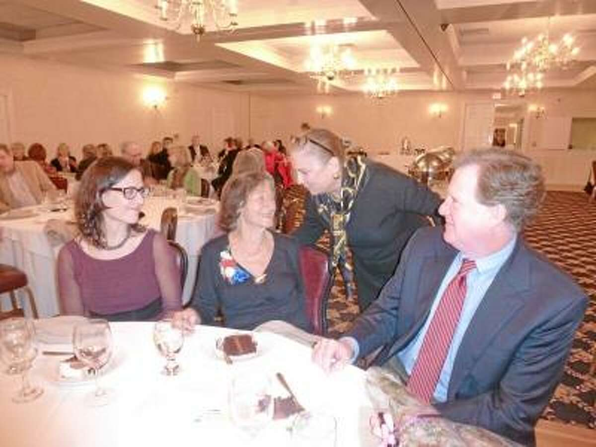 Submitted Photo Marie Wallace with her son and daughter and Honorable Anne C. Dranginis, former Appellate Court Judge.