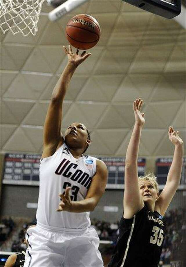 Connecticut's Kaleena Mosqueda-Lewis goes up for a basket while guarded by Vanderbilt's Kendall Shaw in the first half of a second-round game in the women's NCAA college basketball tournament in Storrs, Conn., Monday, March 25, 2013. Connecticut won 77-44. (AP Photo/Jessica Hill) Photo: ASSOCIATED PRESS / AP2013