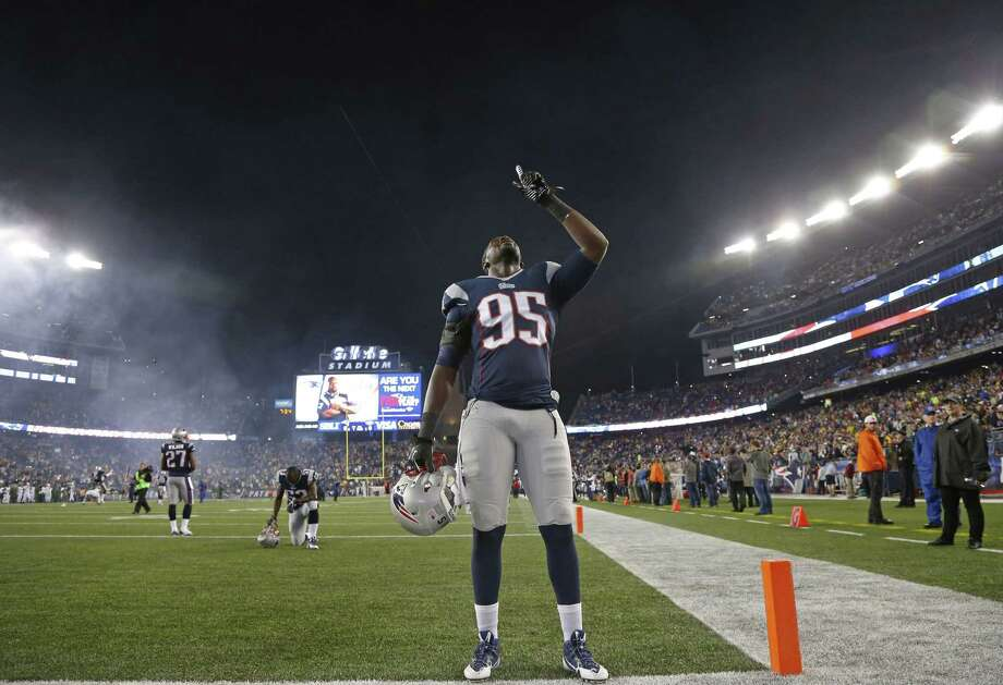 New England Patriots defensive end Chandler Jones will miss Sunday's game against the Chicago Bears. Photo: Elise Amendola — The Associated Press  / AP