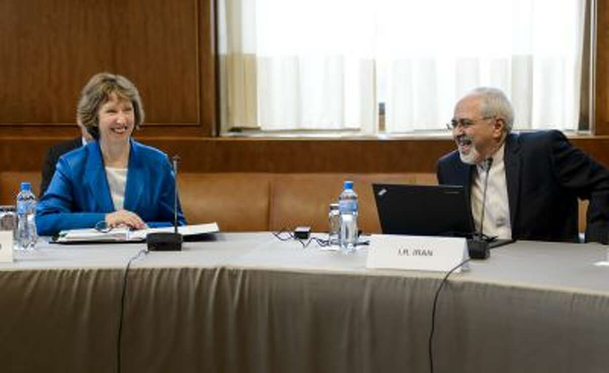 EU High Representative for Foreign Affairs Catherine Ashton, left, and Iranian Foreign Minister Mohammad Javad Zarif share a light moment at the start of the two days of closed-door nuclear talks on Oct. 15, at the United Nations offices in Geneva, Switzerland.