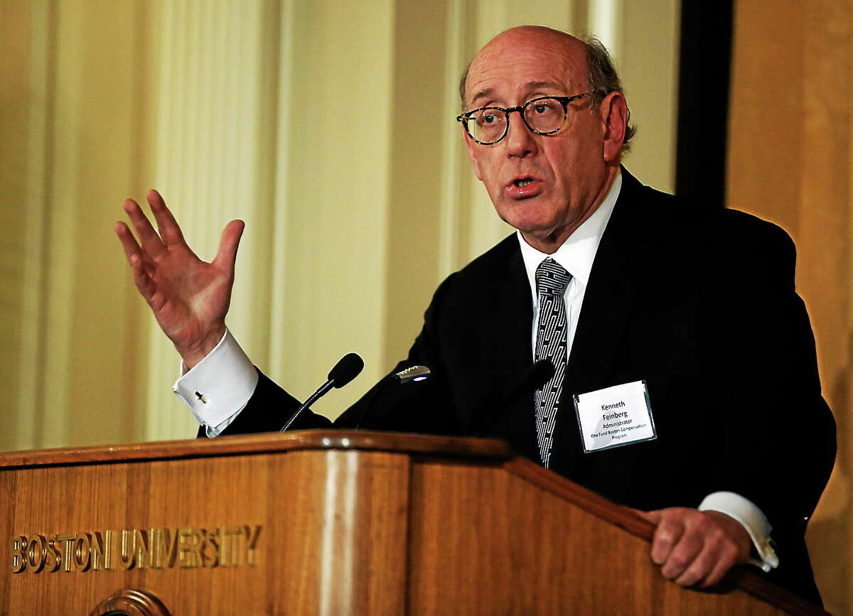 In this March 24, 2014 photo, Kenneth Feinberg, administrator of the One Fund Boston Compensation Program, speaks at a forum at Boston University in Boston.