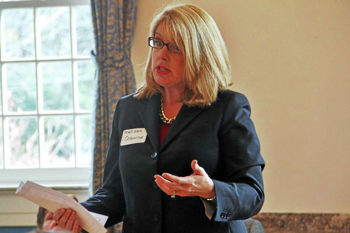 Melissa Osborne, the Democratic candidate for Connecticut's 8th Senate District, speaks during a legislative forum at Prime Time House Tuesday in Torrington.