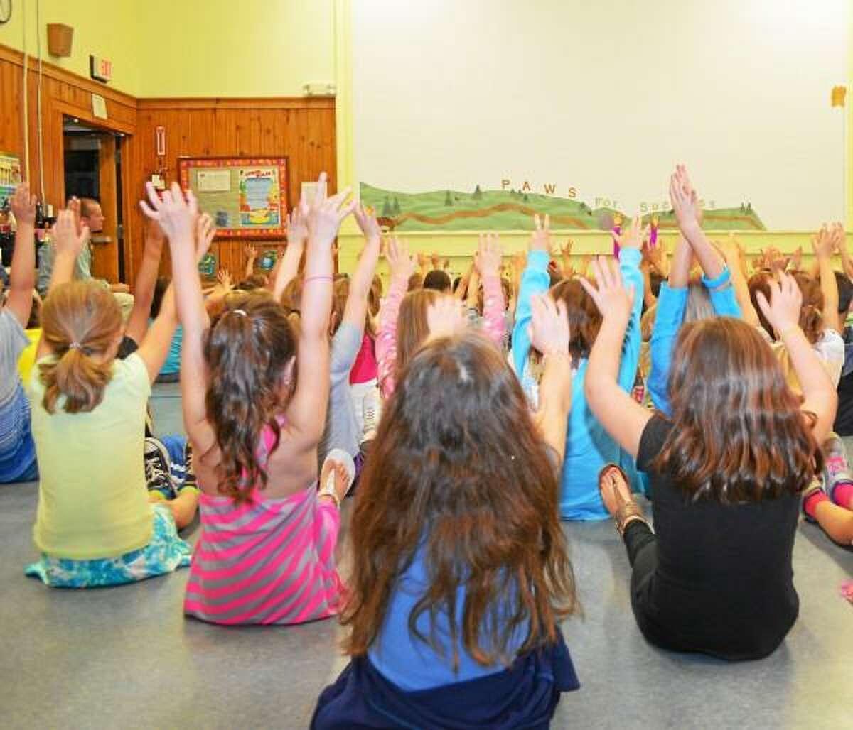 Students at New Hartford's Bakerville School listen to Miss Connecticut, Emily Audibert, speak about healthy living during a presentation Monday. (Jenny Golfin/Register Citizen)